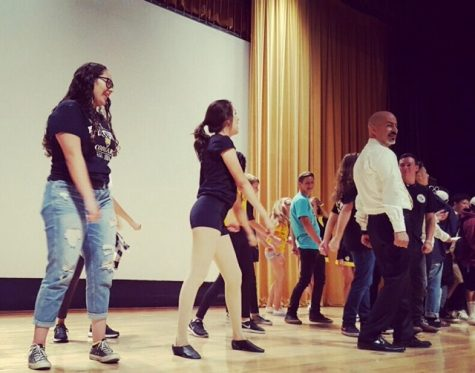 From left to right: Chanelle Irabien, Natali Vazquez, Carlos Cohen performing the Backpack Dance for incoming freshmen