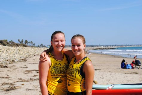 Senior, Peyton Reynolds, pictured right, finishes the race alongside her friend Sophie Elliot. Photo by: Samantha Franks