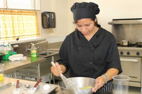 Senior Dora Estrada whisking eggs for her dish. Photo by: Sarah Clench