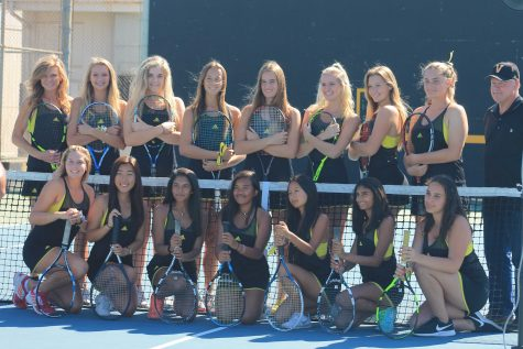 Girls tennis poses for picture day before their match! Photo by: Hailey Cox
