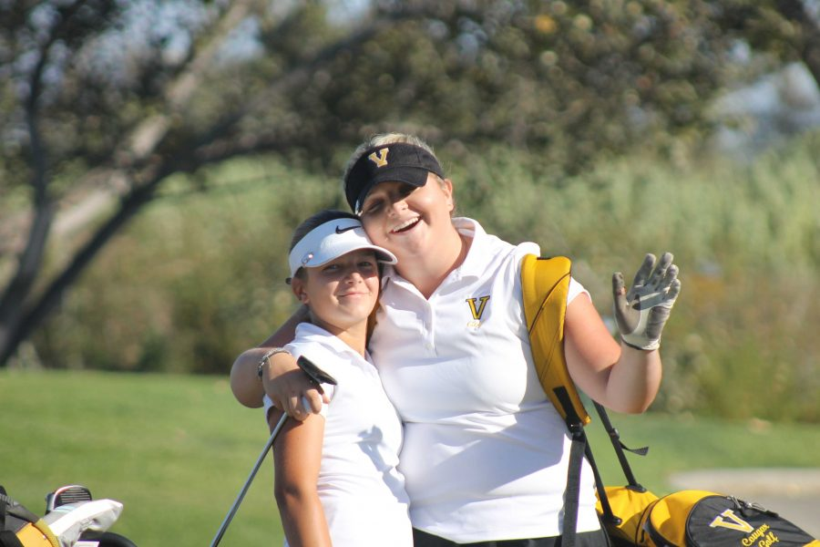 Freshman Carlee Stevenson (El Camino athlete) (left) and Block (right) smile after they tee off the fifth hole.