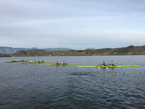 Varsity girls practicing in two fours and two doubles to prepare for their race. Photo by: Sailor Hawes