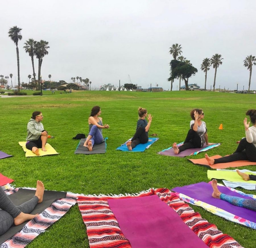 Yoga in the Wild, being practiced at Marina park in  Ventura, CA. Photo from Instagram: @ventura.pop.up.yoga