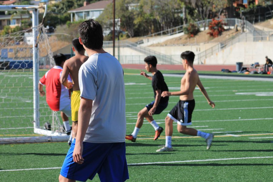 Sometimes during practice, the boys scrimmage each other to practice their skills. Photo by: Hector Heredia