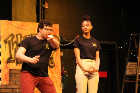 Seniors and Improv Troupe captains, Acacia Harrell and Louis Santia, go over the rules of the show and point out the location of the restrooms before the games begin. Photo by: Miles Bennett