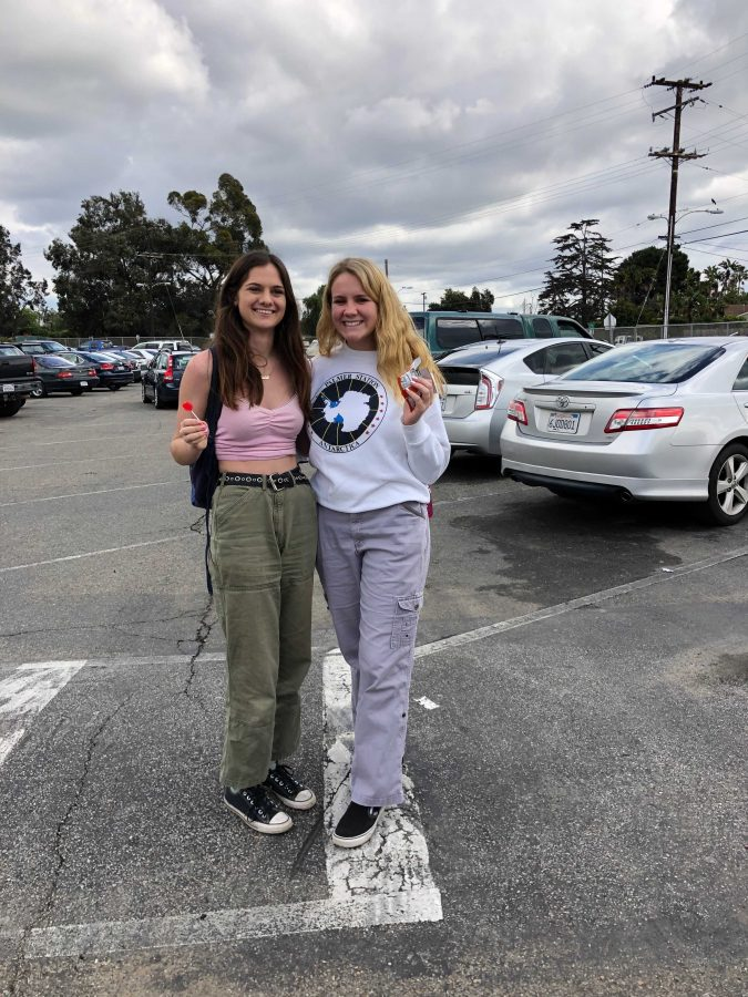 Seniors Julia Offerman (left) and Lizzy TePaske (right) smiling, wearing their cargo pants. Offerman commented,
