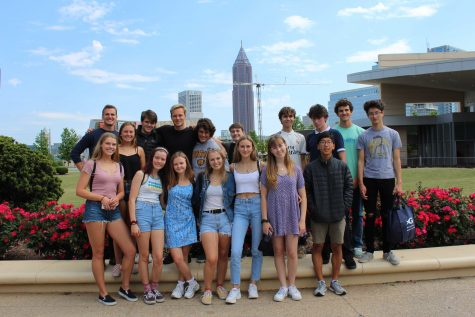 The Wind Ensemble II musicians stand in front of the Atlanta skyline after exploring the Georgia Aquarium. Photo from: Kate Marsden