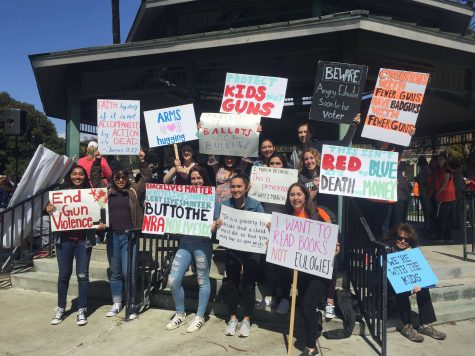 Students with their protest signs after the march. Photo by Brooke Stevenson