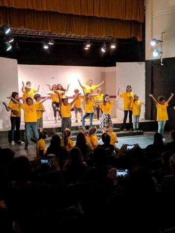 The oldest kids that attended the theater camp performed a kick line. Photo by: Stefoni Rossiter