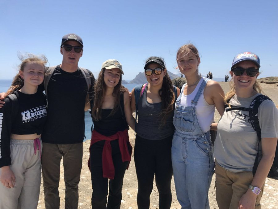 (From left to right) Junior Tanya Turchin, seniors Andy McCombs, Amanda Malotte, Rafaela Rosales, sophomore Olivia Jacobson, and senior Peyton Reynolds posing for a picture during their trip to the island. Photo by: Lily Lara