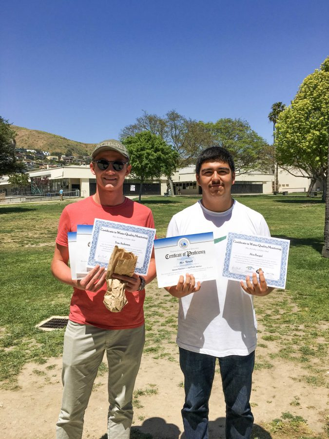 Photo By: Ryan King — Anderson and Rangel proudly holding up their certificates of completion from the ROP Honors Environmental Field Studies course and their internship with the National Park Service.