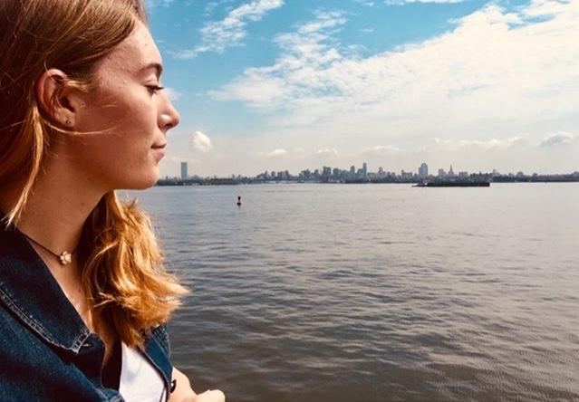 Senior Sammy Pedersen looks out on New York City from the Staten Island Ferry. Photo from Instagram: @samanthaa.christine
