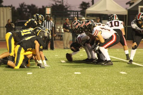 The Ventura Cougar's defensive linemen lining up on the ball. Photo By: Edna Ordonez, VHSBlackGold
