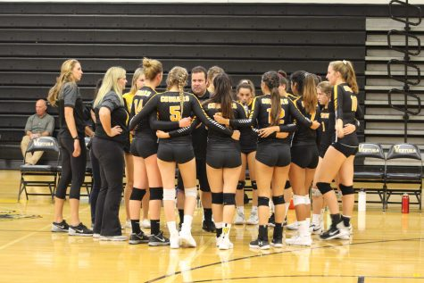Cougars huddle and listen to their coach, Bryan Ornelas, during a timeout. Photo by: Summer Yovanno