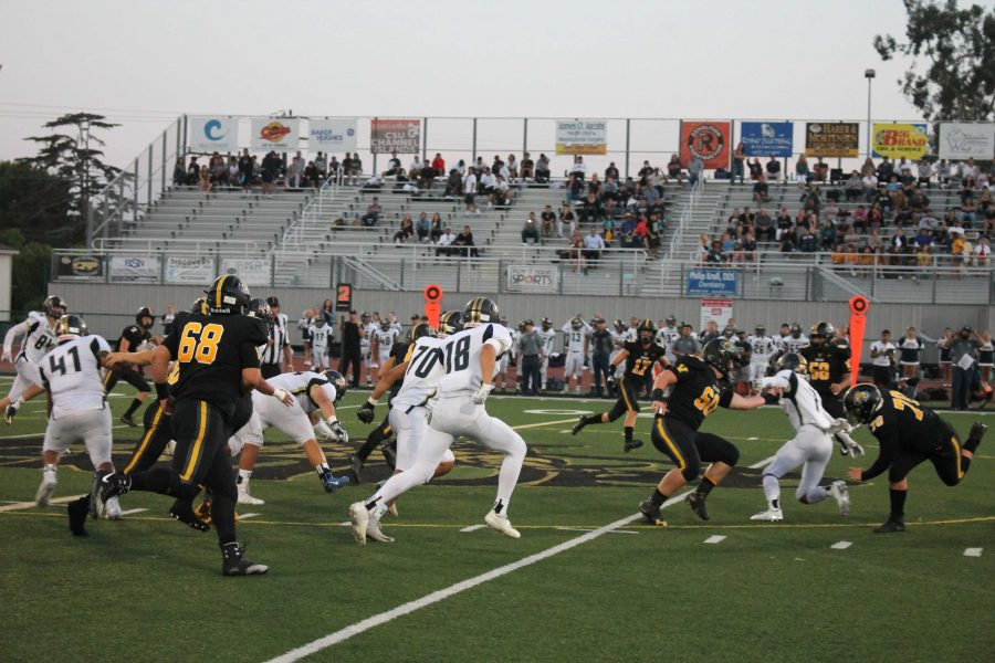 The Cougars offense running a screen play in the second quarter. Photo by: Miles Bennett