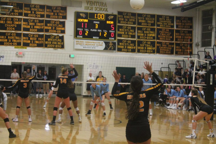 Senior Tatum Teel (number five) serving against Buena. Photo by: John Studebaker
