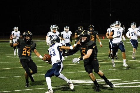 Linebackers Aiden Garza(number 24) and TJ Barlow(number five) attempting to complete a tackle. Photo by: Ryan King
