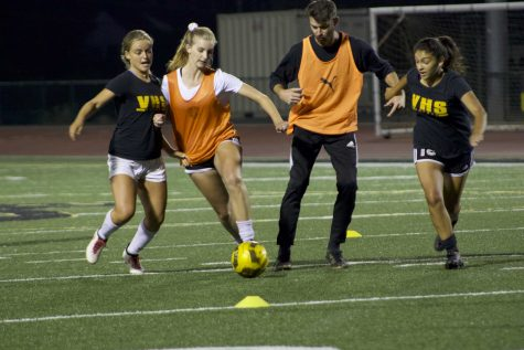 (From left to right) Seniors Elieah Boyd and Alyssa Moore, coach Nick Frannick and junior Tiffany Hernandez scrimmaging on the first tryout night. Photo By: Summer Yovanno