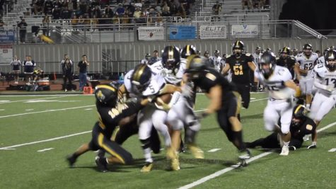 The Cougars heading towards the end zone in the first quarter. Photo by: Miles Bennet