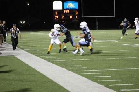 Junior Jadon Cline (number 17) breaking a tackle before being pushed out of bounds. Photo By: Gavin Cross
