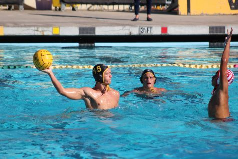 Junior Micah Amico (number 15) pumping back for a pass. Photo By: Gavin Cross