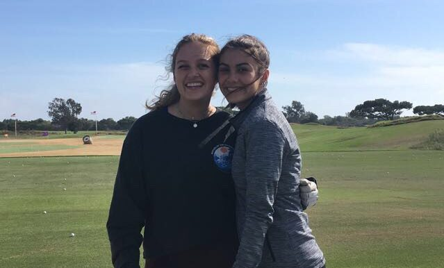 Emma Lisle and Olivia Ramirez at golf practice. Photo by: Breanna Burke