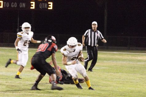 Senior Noah Conboy (number eight) ready to lower his shoulder for the hit. Photo by: Gavin Cross