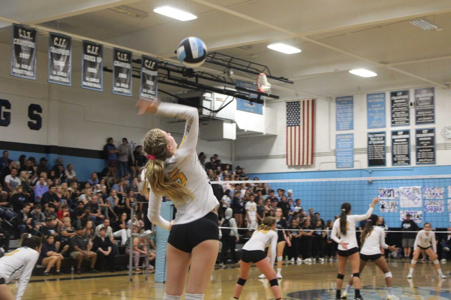 Senior captain Tatum Teel, serving for the point. Photo by Ashlynn Velarde, VHS Yearbook