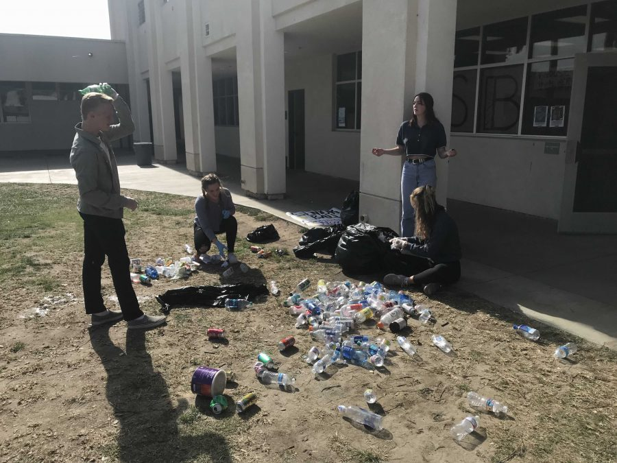 ASB representatives sorting through the recycled materials, making sure they can be sent to the plant. Photo by: Emily Neitz