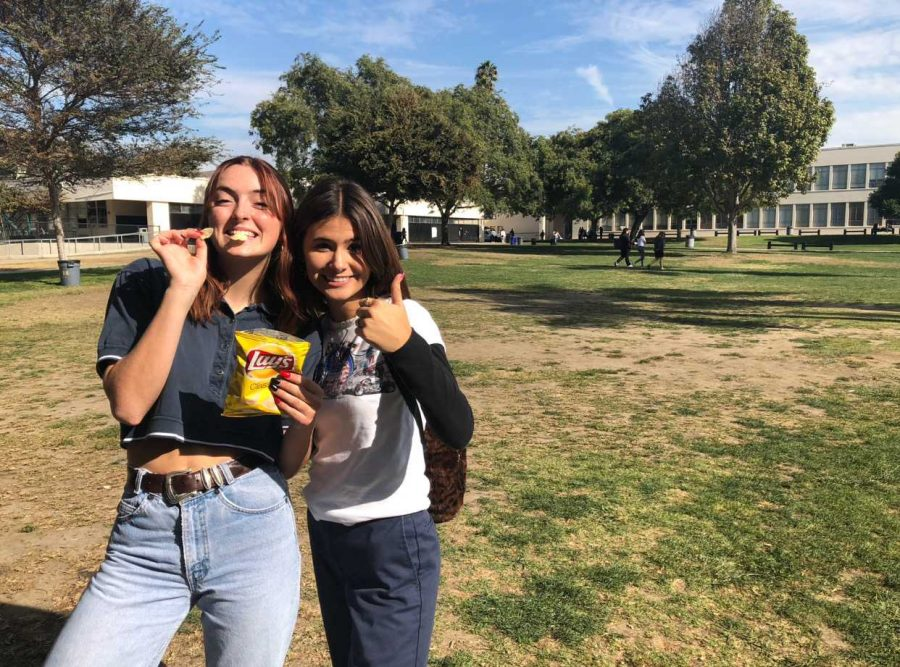 Senior River Winn (left) and sophomore Julianna Jacobs-Vargas (right) getting super pumped for their bank accounts to go in the single digits after all the cyber Monday deals they plan to snag. Photo By: Janelle Chavira
