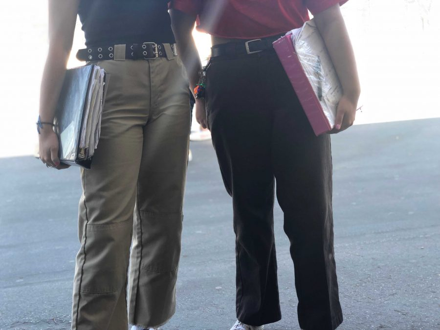 Juniors Kayla Swain (left) and Christine Trujillo (right) agreed that Dickies are more comfortable than skinny jeans and tight pants. Photo by: Sarah Clench
