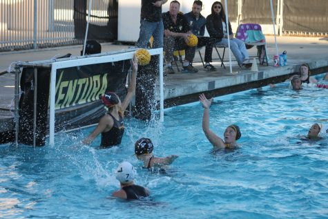 Sophomore goalie Lindsey McDermott blocks a shot early in the game. Photo by: Doug Sandford