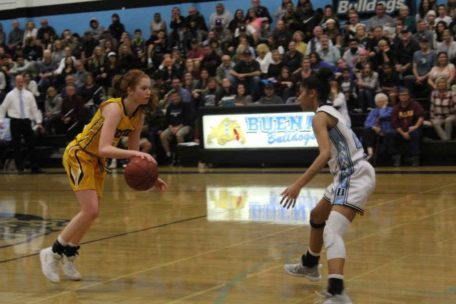 Junior+guard+Sammie+Henley+%28number+25%29+dribbles+forward+as+a+Buena+player+moves+to+intercept+her.+Photo+by%3A+Dylan+Gildea