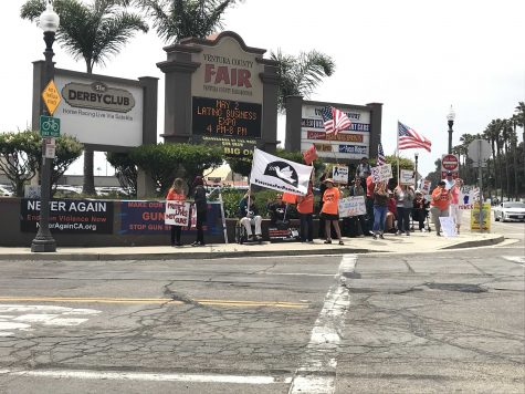 Protesters stand at the entrance to the County Fairgrounds. The website for NeverAgainCA – the Ventura chapter of which organized the protest – can be reached at https://neveragainca.blogspot.com. Photo by: Micah Wilcox