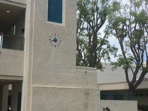 The blue clock that sits facing the senior lawn from the office side of it. Photo by: Garrett Jaffe