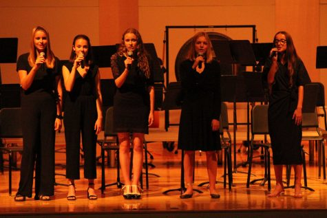 (From left to right) Sophomore Carly Froelich, freshman Aliza Barroca, senior Molly Sturgeon, sophomore Eden Harnar and sophomore Eden Shoemake, the singers of the VHS Music Department
