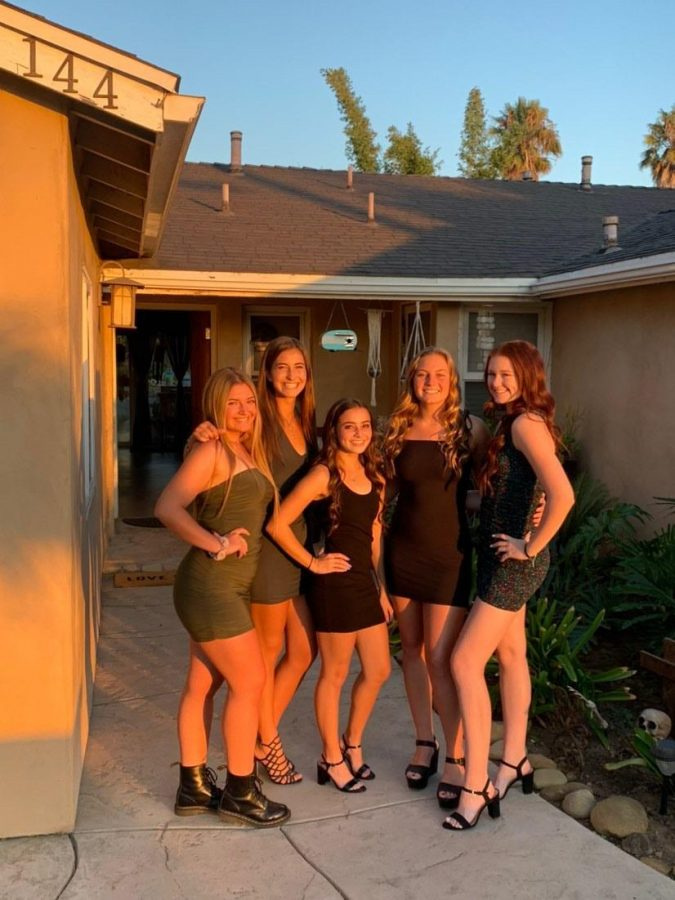 From left to right, seniors Kambria Haughton, Senna Togneri, Tatum Schmidt, Megan Ditlof and Samantha Henley styled heels or boots with a range of colored short skin tight dresses. Photo from Megan Ditlof