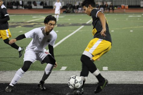 "Senior, Brian Rea playing defense and juggling the ball away from Carpinteria. Head coach, Claudio Lonardo, commented, ""We've been working on new formations and we have a lot of new players so it"