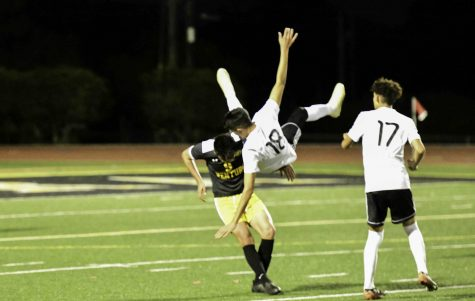 Senior Danny Gutierrez (number 9) sends Pacifica (number 18) flying. Photo by: Gene Dunn