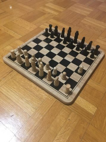 In this photo, a white pawn has moved two spaces forward to start off the game. Typically, the white side in a chess game will start off first. Photo by : Emily Nguyen
