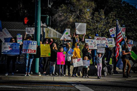Parents take the streets protesting against the possible vaccine mandate for schools. Featuring Senior, Cougar Press interviewer Rachel Gonzalez as the only mask wearer. Photo by: Adi De Clerck