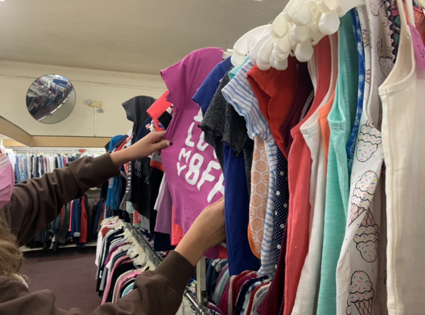 Sophomore Kaylee Philips thrift shopping in downtown Ventura at The Arc Foundation thrift store. The Arc Foundation donates proceeds to the Arc of Ventura County, an organization that helps those with disabilities. Photo by: Ava Mohror