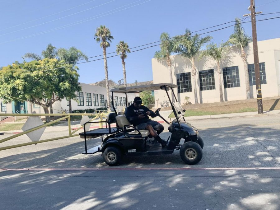 Campus supervisors are stationed all around the VHS campus during breaks, and during class. Pictured is supervisor Aaron Triana on the VHS golf-cart, watching the Poli St. side of campus during 6th period. Photo by: Elise Sisk