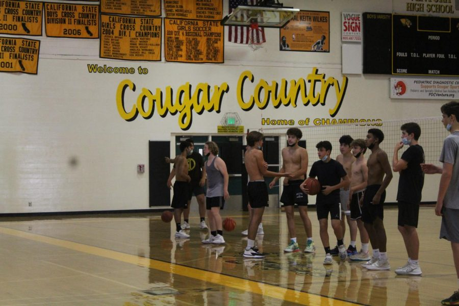 Boys JV and Varsity interacting at practice with each other. Photo by: Halle Gentry