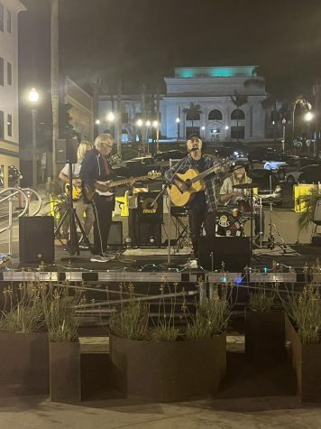 Local performer J Peter Boles playing with his band on Main Street on Saturday, Oct. 10. Boles is a musical veteran whos played a large variety of self-written folk songs for over 22 years. Photo by: Joseph Lombardo
