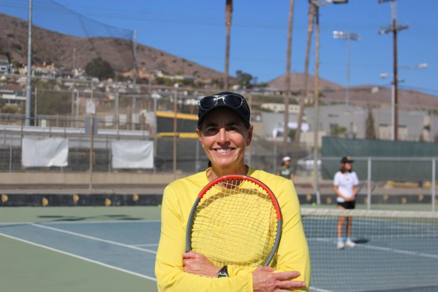 On top of teaching the girls VHS tennis team Allison Ferguson also has a podcast called Empowering Women Through Sports available on Spotify. Photo by: Jade Buck