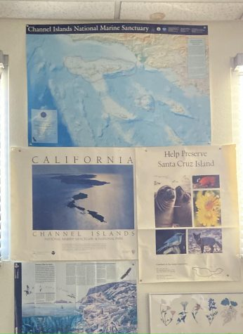 Rob Lewis biology and chemistry classroom displays posters of some Ventura islands and sanctuaries. Photo by: Sophia Denzler