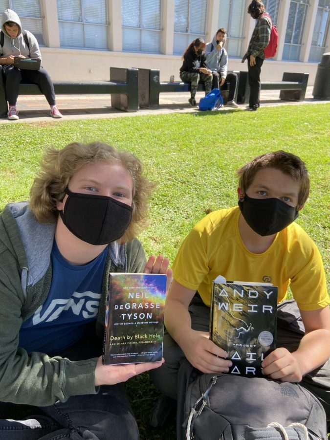 Juniors Reece Pickett and Joseph Wronkiewicz (left to right) are reading Death by Black Hole by Neil deGrasse Tyson and Project Hail Mary by Andy Weir. Photo by: Sophia Denzler